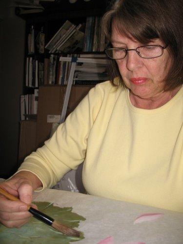 Artist Darlene Kaplan at work in her studio.