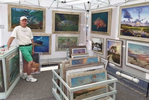 Artist Keith Martin Johns in his art show booth