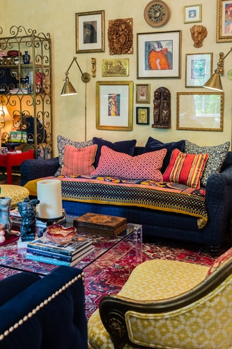 Room filled with art in a Bohemian style, designed by Carol Marcotte. Read her interview at www.ArtsyShark.com
