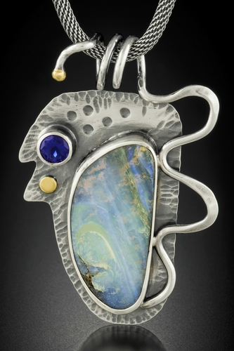 """Boulder Opal Alchemy"" Boulder Opal, Lolite, Sterling Silver and 18 kt Gold, 1.25"" x 1.5"" x .25"" by artist Dawn Middleton. See her portfolio by visiting www.ArtsyShark.com"