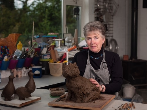 Artist Gilly Thomas in her studio. See her portfolio by visiting www.ArtsyShark.com