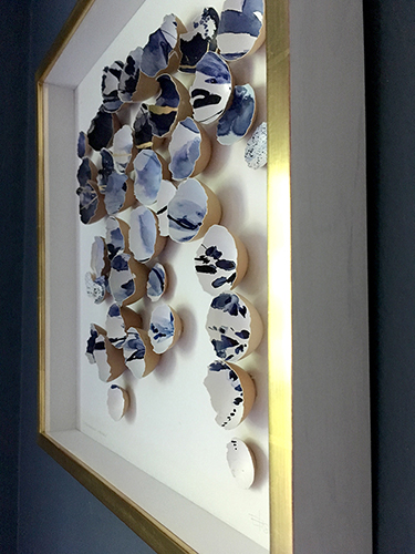 Artwork by Elisa Sheehan with eggshells painted in Kintsugi fashion