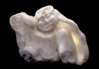 Stone sculpture of a woman's upper torso by Darcy Meeker