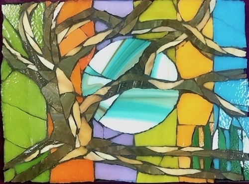 Abstract glass mosaic of the moon behind tree branches by Carol Davis