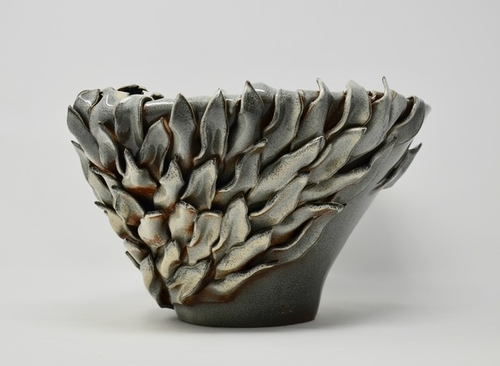 Hand thrown contemporary vase with hand cut leaves by Daniela Kouzov