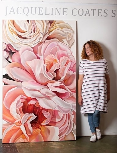 "Artist Jacqueline Coates with her painting ""Calvacade of Cream Roses"""