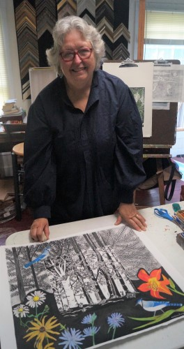 Artist Audrey Kay Dowling working on a mixed media piece