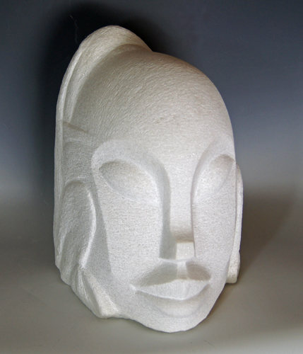 abstract carved marble head by Jean-Frederic Batasse