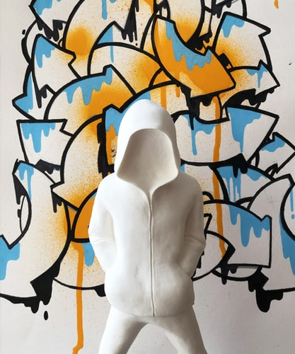 white hoodied figurative sculpture with graffiti background by Rob Lenihan