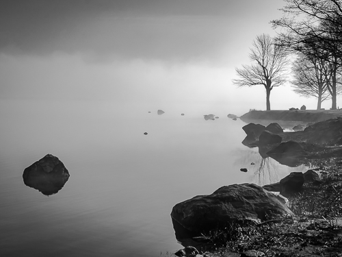 B & W photography of a lake by Mark Roger Bailey
